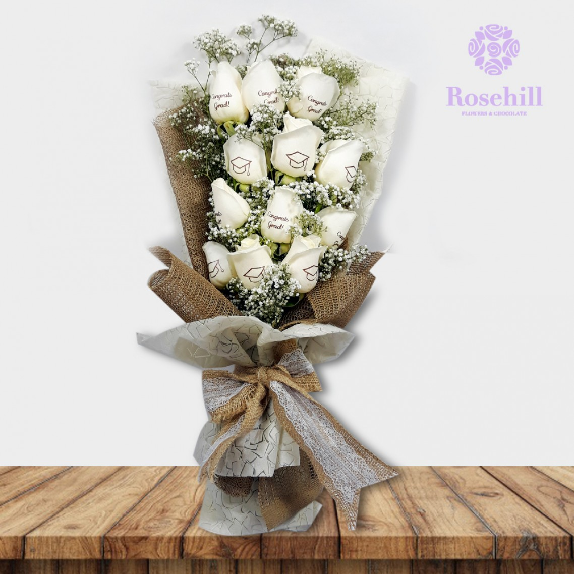 1524674156-h-250-_Rosehill's Graduate Bouquet with Babys Breath- White.jpg